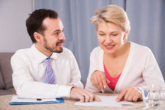 Woman and manager sign contract Royalty Free Stock Photography