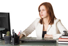 Woman manager sitting at the computer Royalty Free Stock Photos