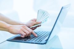 A woman managing her money finances on computer, online banking. Shopping online stock photography