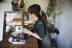 Woman managing a small bakery house Royalty Free Stock Image