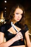 Woman maniac with knife. Underground parking Stock Photo
