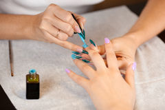 Woman at manicure Royalty Free Stock Photos