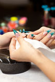 Woman at manicure Royalty Free Stock Image