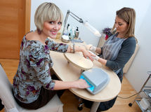 Woman in manicure salon Stock Photography