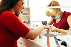 Woman at manicure treatment Stock Photo
