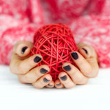 Woman manicured hands holding deco ball Stock Images
