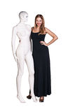 Woman with mannequin. Beautiful young woman with mannequin isolated on white Royalty Free Stock Photos