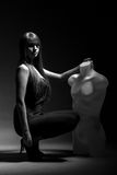 Woman with mannequin in the dark Royalty Free Stock Photo