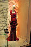 Woman mannequin with red dress in showcase Stock Images