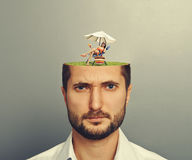 Woman in mans head Stock Photography