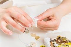 Woman manually sewing clothes Royalty Free Stock Photo