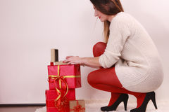 Woman with many christmas gift boxes Royalty Free Stock Photography