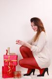 Woman with many christmas gift boxes Stock Photos