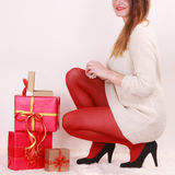 Woman with many christmas gift boxes Stock Images