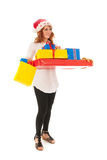 Woman with many Christmas gifts Stock Photos