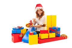 Woman with many Christmas gifts royalty free stock photos