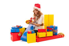 Woman with many Christmas gifts Stock Images