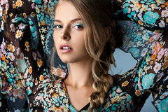 Woman in many-colored blouse Stock Photos