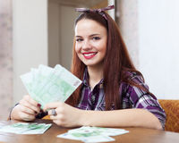 Woman with many euro in home Royalty Free Stock Photos