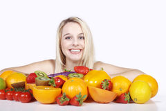 Woman with many fruit species Stock Photos