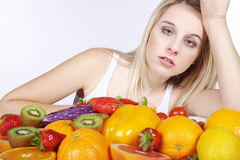 Woman with many fruit species Royalty Free Stock Photo