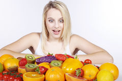 Woman with many fruit species Stock Image