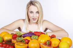 Woman with many fruit species Royalty Free Stock Image