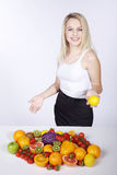 Woman with many fruit species Stock Photography