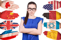 Woman and many hands with different flags Royalty Free Stock Photography
