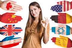 Woman and many hands with different flags Stock Photography