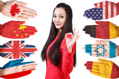 Woman and many hands with different flags Stock Photo