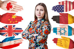 Woman and many hands with different flags Stock Image