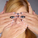 Woman with many hands. Face shot of a woman with many hands royalty free stock images
