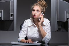 Woman with many job duties Royalty Free Stock Photography