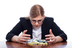 Woman with many pills Royalty Free Stock Photo