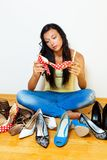 Woman with many shoes to choose from Stock Photo