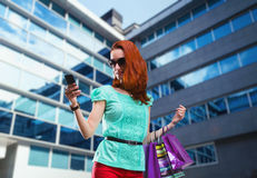 Woman with many shooping bags Stock Photo