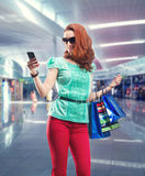 Woman with many shooping bags Stock Images
