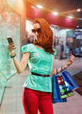 Woman with many shooping bags Royalty Free Stock Image