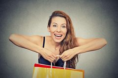 Woman with many shopping bags on gray background Stock Photography