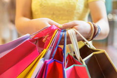 Woman with many shopping bags Stock Images