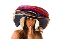 Woman with many summer beach hats. On her dead royalty free stock photo