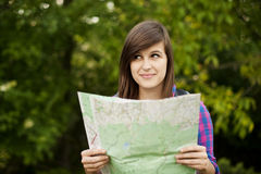 Woman with map. Hiking collection: beautiful young woman holding a map Royalty Free Stock Photography