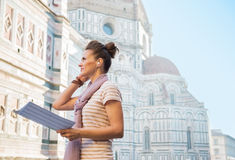 Woman with map and audio guide in florence, italy Royalty Free Stock Photo