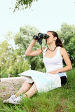 Woman with a map and binoculars Royalty Free Stock Photos