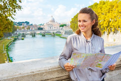 Woman with map on bridge ponte umberto I in rome Stock Images
