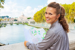 Woman with map on bridge ponte umberto I in Rome Stock Photos