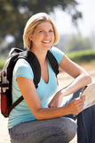 Woman with map on country walk Stock Image
