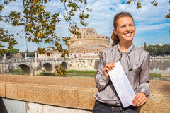 Woman with map on embankment in rome italy Stock Photos