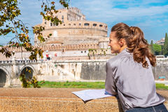 Woman with map on embankment in rome italy Royalty Free Stock Photos